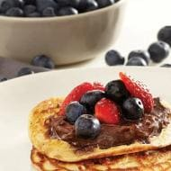Mini blueberry buttermilk pancakes with Nutella® and strawberries